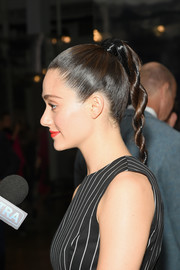 Emmy Rossum kept it sleek and chic with this tight braid at the Carolina Herrera fashion show.