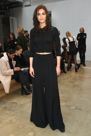 Hilary Rhoda kept it simple and classic up top in a black cardigan when she attended the Carolina Herrera fashion show.