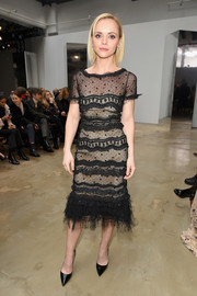 Christina Ricci was classic and demure in a lacy LBD at the Carolina Herrera fashion show.