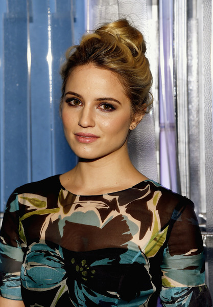 Dianna Agron was elegantly coiffed with a loose, high bun at the Carolina Herrera fashion show.