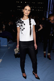 Jordana Brewster was equal parts edgy and feminine in a black-and-white floral-accented top by Carolina Herrera during the label's fashion show.