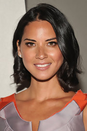 Olivia Munn's cute, curled bob is an option for dressing up a more casual 'do. Simply blow-dry so tresses are smooth, then use a medium-barreled curling iron to add a few soft waves to hair ends. To finish, tousle with fingers.