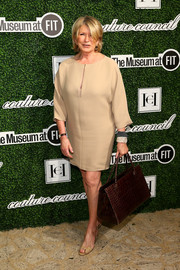 Martha Stewart paired her mini dress with an elegant brown crocodile tote.