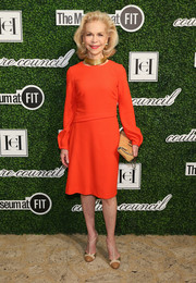 Lynn Wyatt styled her dress with a pair of tricolor T-strap pumps.