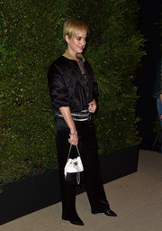 Katy Perry's black Chanel satin jacket and pants combo at the Gabrielle bag celebration was a sporty-chic way to suit up.
