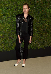 Teresa Palmer was all about cool glamour in a pearl-buttoned leather jacket by Chanel at the Gabrielle bag celebration.