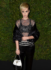 Katy Perry styled her look with a black-and-white leather purse by Chanel.