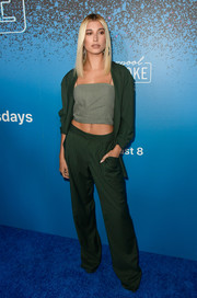 Hailey Baldwin looked cool in a slouchy green pantsuit by Baja East at the launch of 'Carpool Karaoke: The Series.'