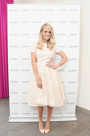 Carrie Underwood worked a vintage-meets-modern vibe in a cream-colored fit-and-flare cutout dress by Bibhu Mohapatra during the Almay Fresh-Faced Beauty Day.