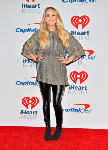 Carrie Underwood Ankle Boots [clothing,carpet,footwear,tights,outerwear,electric blue,red carpet,knee-high boot,flooring,premiere,carrie underwood,iheartradio music festival,press room,las vegas,nevada,t-mobile arena]