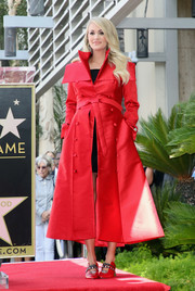 Carrie Underwood cut a chic figure in a red taffeta trenchcoat by John Paul Ataker during her Hollywood Walk of Fame ceremony.