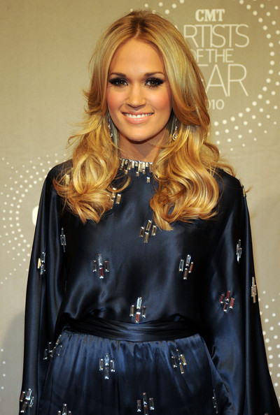 Carrie Underwood Layered Cut [hair,clothing,blond,hairstyle,beauty,fashion,lip,outerwear,fashion model,long hair,carrie underwood,honoree,franklin,tennessee,the factory,red carpet,cmt artists of the year]
