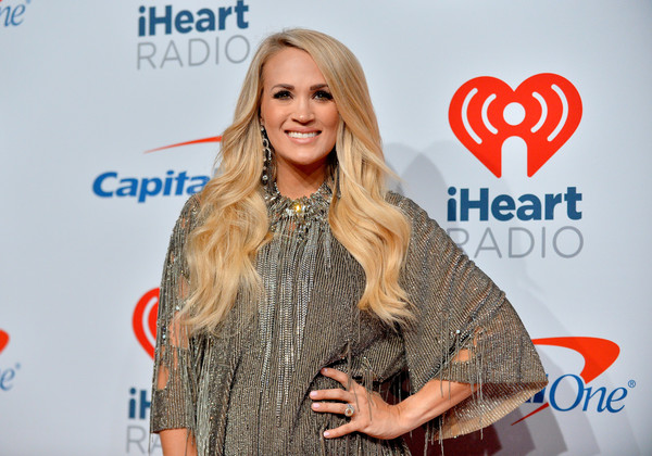 Carrie Underwood Long Wavy Cut [face,red,beauty,blond,fashion,yellow,long hair,performance,event,smile,carrie underwood,iheartradio music festival,press room,las vegas,nevada,t-mobile arena]