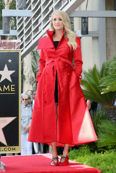 Carrie Underwood Trenchcoat [clothing,red,outerwear,pink,fashion,coat,overcoat,trench coat,robe,blond,carrie underwood honored with star on the hollywood walk of fame,the hollywood walk of fame,hollywood,california,star,carrie underwood]