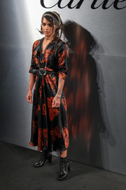 Lisa Bonet donned a black and orange butterfly-print dress for the Santos de Cartier watch launch.