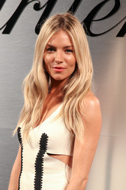 Sienna Miller sported her signature boho waves at the Santos de Cartier watch launch.