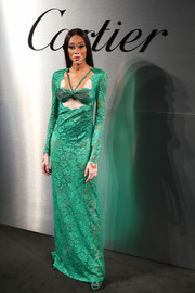 Winnie Harlow sizzled in a semi-sheer green lace cutout gown by Dundas at the Santos de Cartier watch launch.