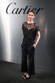 Sofia Coppola chose a loose black lace blouse for the Santos de Cartier watch launch.
