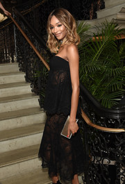Jourdan Dunn arrived for the Cartier Fifth Avenue grand reopening sporting a gold box clutch and strapless dress combo.
