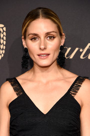 Olivia Palermo spruced up her 'do with a pair of black statement earrings.