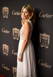 Sienna Miller flaunted a stunning pair of diamond bracelets during the Cartier Fifth Avenue grand reopening.
