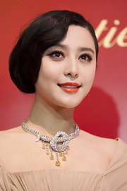Fan Bingbing added a squeeze of mandarin lipstick while attending the Cartier event. It was a nice complement to her dazzling jewels.