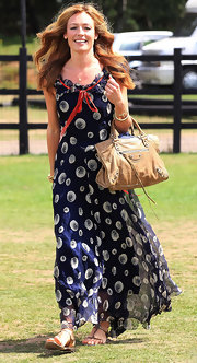 Cat Deeley paired her printed maxi dress with a tan leather shoulder bag.