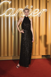 Elizabeth Debicki sparkled in an embellished black halter gown at the Cartier Precious Garage Party.