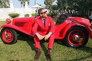 Lapo Elkann stood out in a bright red suit over a gingham shirt at the 2013 Cartier Travel with Style.