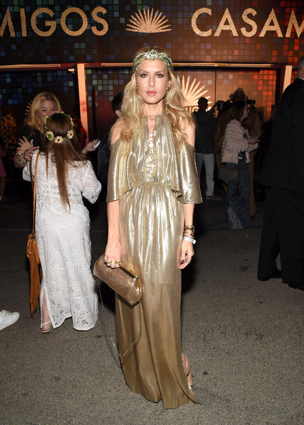Rachel Zoe looked radiant sporting this gold purse and gown combo at the Casamigos Halloween party.