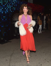Cindy Crawford donned a color-block halter dress and a white fur stole for the Casamigos Halloween party.