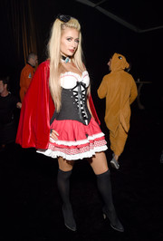 Paris Hilton made a sexy Little Red Riding Hood in a  corset dress, complete with a red cape, at the Casamigos Tequila Halloween party.