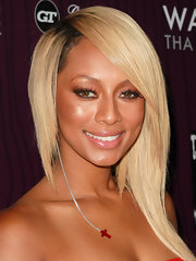Keri Hilson arrived at the Cash Money Records' Lil Wayne album release party for 'The Carter IV' with a cool asymmetrical cut and lots of face-framing layers.