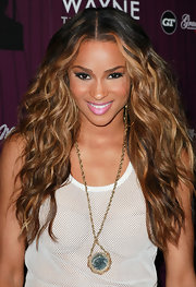 Ciara arrived with tresses flowing to Cash Money Records' Lil Wayne Album Release Party for 'Tha Carter IV'. To recreate the look,  part hair down the center and use a large-barreled curing iron or enhance your own natural waves or curls. To keep hair shiny, we recommend an anti-frizz treatment like Josie Maran Argan Oil Hair Serum.