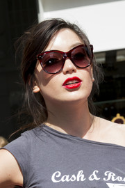 Daisy Lowe wore her hair in a loose, messy bun at the Cash & Rocket photocall.