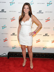 Beth Shak was a stunner in a white mini dress that featured a low-cut neckline and subtle shirring on the skirt.