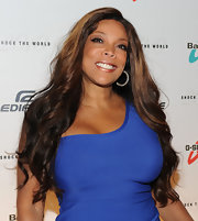 Wendy Williams styled her highlighted locks into soft curls that cascaded down her shoulders.