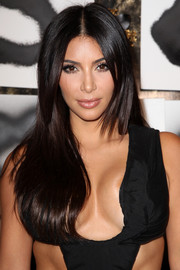 Kim Kardashian sported a sleek center-parted hairstyle during the Artist in Residence event.