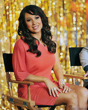 Cheryl Burke wore her hair in soft curls with side-swept bangs for an appearance on 'Good Morning America.'