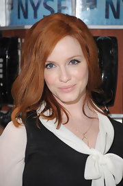 Christina Hendricks wore a pale glossy beige-pink lipstick while ringing in the New York Stock Exchange.