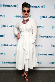 Debi Mazar opted for a belted white shirtdress when she visited the SiriusXM studios.