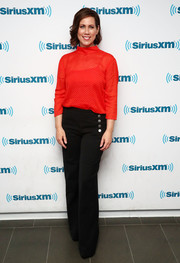 Miriam Shor visited SiriusXM wearing a semi-sheer red turtleneck from & Other Stories.