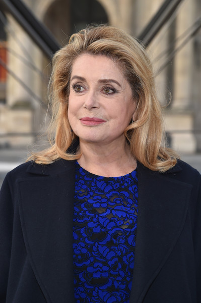 Catherine Deneuve Medium Wavy Cut [hair,face,beauty,fashion,hairstyle,electric blue,street fashion,blond,lip,outerwear,catherine deneuve,front row,part,paris,france,louis vuitton,paris fashion week womenswear fall]