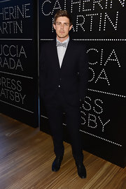 Chris Lowell channeled his own version of Gatsby with this classic suit and bow tie at the Catherine Martin and Miuccia Prada Dress Gatsby Opening.
