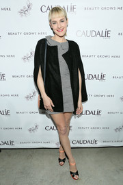 Jena Malone went for some retro charm in a vintage black cape layered over a gingham dress during the Caudalie Boutique Spa grand opening.