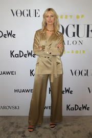 Karolina Kurkova attended the Celebrate 40 Years — Best of Vogue Salon event wearing a beige satin jacket and wide-leg pants combo.