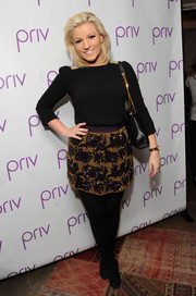 Natalie Coyle attended the PRIV launch wearing a simple black three-quarter-sleeve blouse.