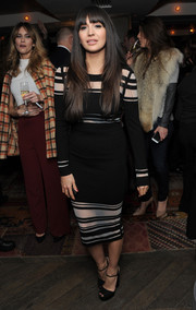 Zara Martin kept it modern and chic in a black-and-white sheer-striped dress during the launch of PRIV.