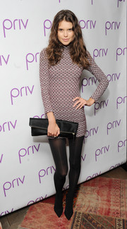 Sarah Macklin channeled the '60s in a long-sleeve, high-neck mini dress during the launch of PRIV.