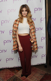Jade Williams bared a bit of abs in a white crop-top during the launch of PRIV.